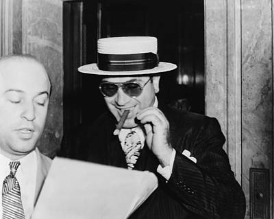 Al Capone, With A Cigar And A Big Poster by Everett