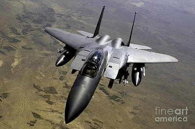 An F-15e Strike Eagle Aircraft Poster by Stocktrek Images