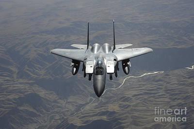 An F-15e Strike Eagle Flies Watch Poster by Stocktrek Images