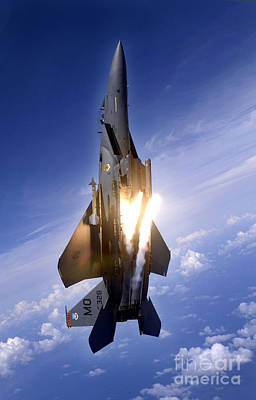 An F-15e Strike Eagle Pops Flares Poster by Stocktrek Images