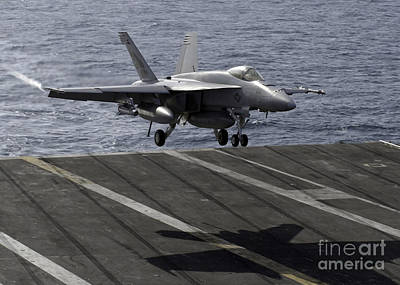 An Fa-18e Super Hornet Prepares To Land Poster by Stocktrek Images