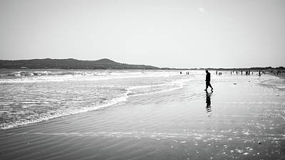 At The Beach - Portmarnock, Ireland - Black And White Street Photography Poster by Giuseppe Milo