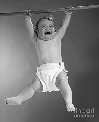Baby Hanging From Rod, Looking Poster by H. Armstrong Roberts/ClassicStock