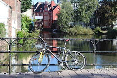 Bicycle By Canal In Belgium Poster by Carol Groenen