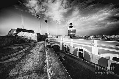Big Sky Over The El Morro Lighthouse And Fort Courtyard Poster by George Oze