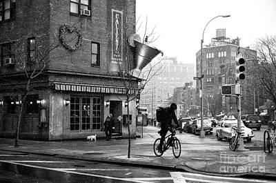Biking In Greenwich Village Poster by John Rizzuto
