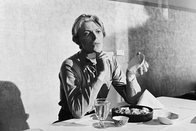 Bowie At Lunch  Poster by Terry O'Neill