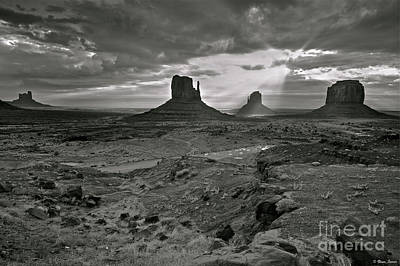 Breaking Light At Monument Valley - Black And White Poster by Brian Stamm