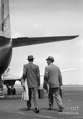 Businessmen Boarding A Plane Poster by Debrocke/ClassicStock