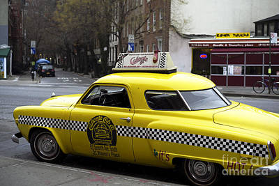 Caliente Yellow Cab Poster by John Rizzuto
