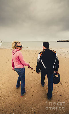 Couple Walking Together On Overcast Beach Poster by Jorgo Photography - Wall Art Gallery