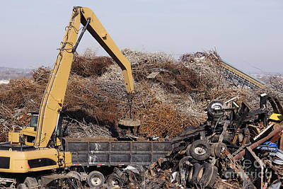 Excavator Moving Scrap Metal With Electro Magnet Poster by Jeremy Woodhouse