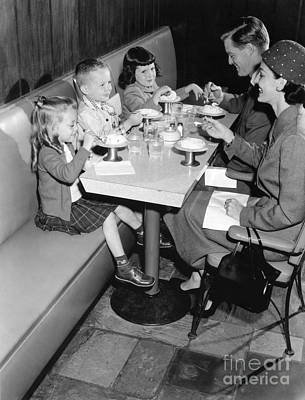 Family Eating Ice Cream At A Diner Poster by H. Armstrong Roberts/ClassicStock