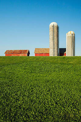 Farm Silos And Shed On Green And Against Blue Poster by Todd Klassy