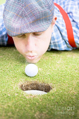 Golf Player Blowing The Ball Poster by Jorgo Photography - Wall Art Gallery