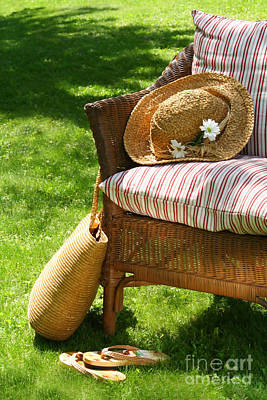 Grass Lawn With A Wicker Chair  Poster by Sandra Cunningham