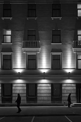Illuminated Building With People Poster by John Williams