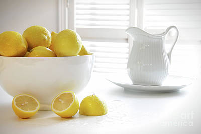 Lemons In Large Bowl On Table Poster by Sandra Cunningham