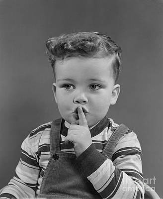 Little Boy Making Shushing Gesture Poster by H. Armstrong Roberts/ClassicStock