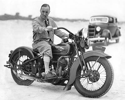 Malcolm Campbell On A Harley Poster by Underwood Archives