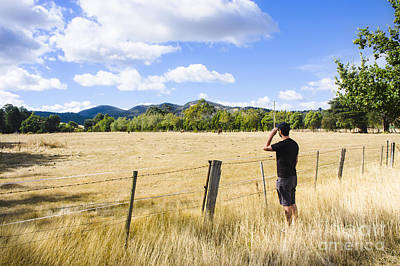 Man Enjoying A Rural Farm Landscape In Hobart Poster by Jorgo Photography - Wall Art Gallery