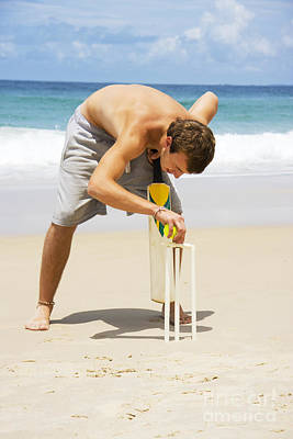 Man Playing Beach Cricket Poster by Jorgo Photography - Wall Art Gallery