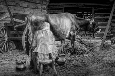 Milk Maid Milking A Cow In The Barn In Black And White Poster by Randall Nyhof