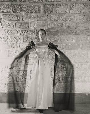 Model Wearing A White Satin Dress Poster by Conde Nast