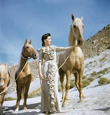 Model Wearing Palomino Beige Dinner Poster by Conde Nast