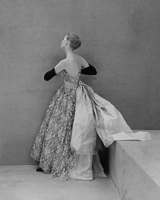 Model Wearing Strapless Lace And Satin Poster by Conde Nast