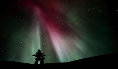Northern Lights Above An Inukchuk In Saskatchewan Poster by Mark Duffy