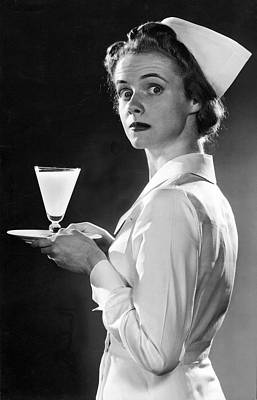 Nurse Carrying A Glass Of Milk Poster by Underwood Archives