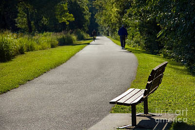 Park Bench And Person On Walking Trail Photo Poster by Paul Velgos