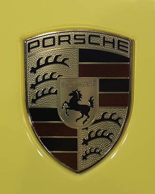 Porsche Emblem On Racing Yellow Poster by Sebastian Musial