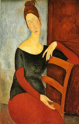 Portrait Of Jeanne Hebuterne On Red Chair Poster by Amedeo Modigliani