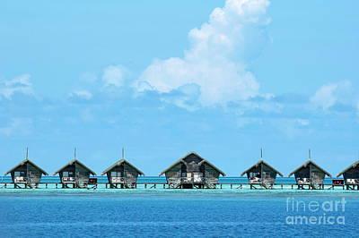 Resort Bungalows Over Sea Poster by Sami Sarkis
