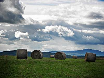 Round Bales Under A Cloudy Sky Poster by Joy Nichols