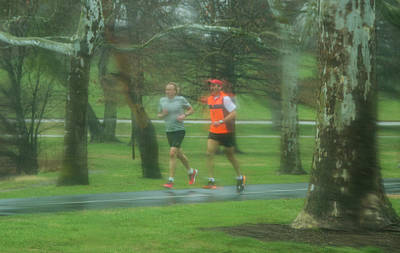 Running In The Rain Throughforest Park Poster by Garry McMichael