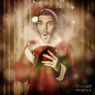 Santa With Surprise Christmas Gift Bag Poster by Jorgo Photography - Wall Art Gallery