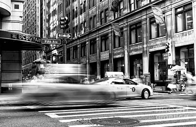 Speed In The City Poster by John Rizzuto