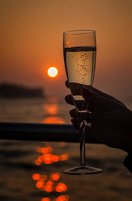 Sun Setting Through A Glass Of Champagne Poster by Jon Ingall
