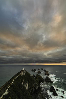 Sunrise At Nugget Point Poster by Ian Riddler