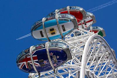 The London Eye And Jet Aircraft Poster by David Pyatt