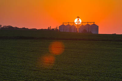 The Sun Sets Behind A Large Commercial Poster by Scott Sinklier