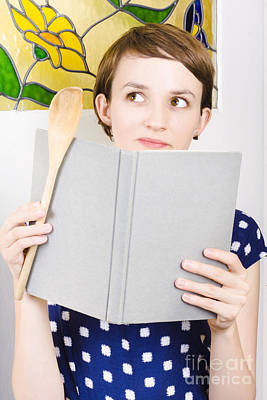 Thinking Woman Reading Cookbook In Kitchen Poster by Jorgo Photography - Wall Art Gallery