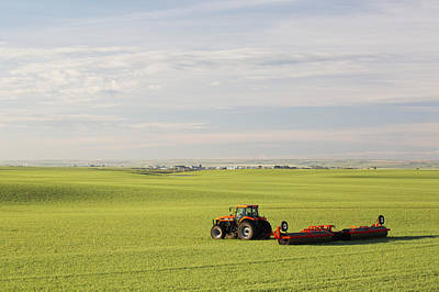 Tractor In A Green Grain Field Pulling Poster by Michael Interisano