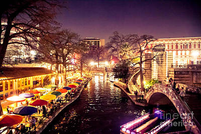 Twilight In The Riverwalk Poster by Iris Greenwell