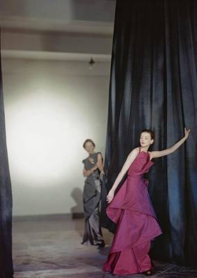 Two Models Wearing Evening Dresses Poster by Conde Nast