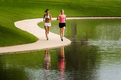 Two Women Jogging Poster by Utah Images