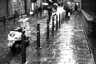 Vespa In The Rain Poster by John Rizzuto